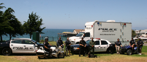 Redondo Beach Police Department vehicles and officers on bluff overlooking ocean